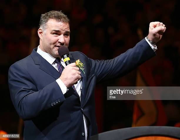 Eric Lindros addresses the fans during a pregame ceremony inducting him and former teammate John LeClair into the Flyers Hall of Fame before the game...