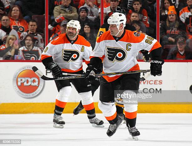 Eric Lindros and John LeClair of the Philadelphia Flyers Alumni skate against the Pittsburgh Penguins Alumni on January 14 2017 at the Wells Fargo...