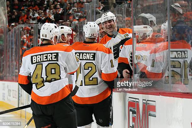 Eric Lindros and Mikael Renberg of the Philadelphia Flyers Alumni celebrate Danny Briere second period goal with teammates Simon Gagne and Todd...