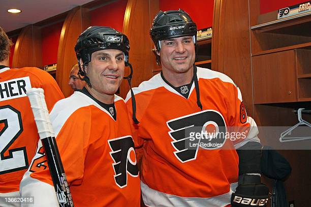Eric Lindros and Rick Tocchet of the Philadelphia Flyers pose for a photo prior to their game against the New York Rangers during the Alumni Game...