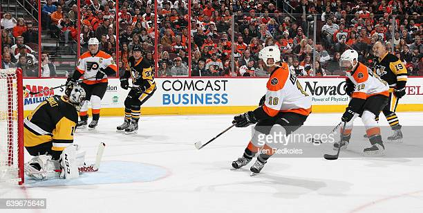 Eric Lindros John LeClair and Mikael Renberg of the Philadelphia Flyers Alumni set up a scoring opportunity in their zone against Jocelyn Thibault...
