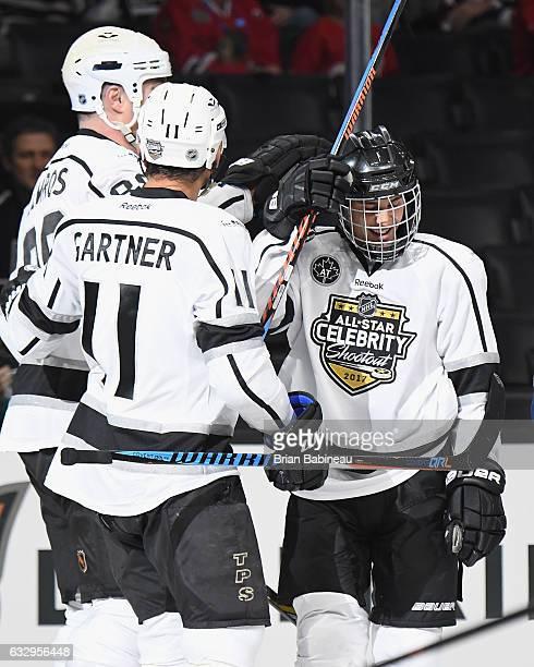 Eric Lindros Mike Gartner and Justin Bieber of Team Gretzky celebrate during the 2017 NHL AllStar Celebrity Shootout as part of the NHL AllStar...