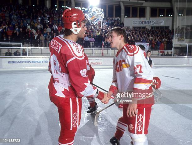 Eric Lindros of Team Canada shakes hands with Alexei Kovalev of the Commonwealth of Independent States after the 1992 World Junior Championships...