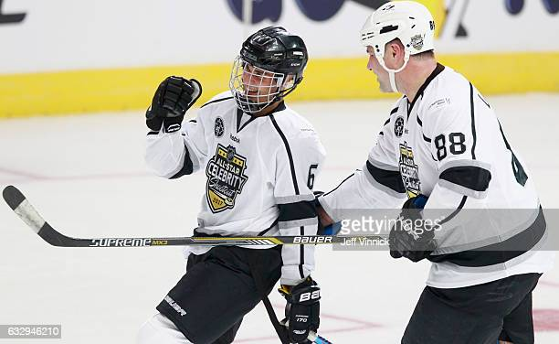 Eric Lindros of Team Gretzky celebrates with Justin Bieber during the 2017 NHL AllStar Celebrity Shootout as part of the NHL AllStar Weekend at...