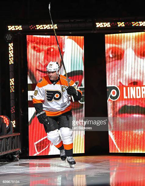 Eric Lindros of the Philadelphia Flyers Alumni skates onto the ice surface during the pregame introductions prior to playing the Pittsburgh Penguins...