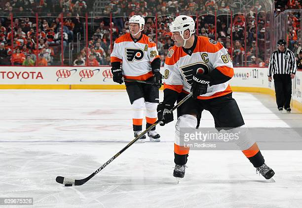 Eric Lindros of the Philadelphia Flyers Alumni skates the puck with teammate Terry Carkner against the Pittsburgh Penguins Alumni on January 14 2017...