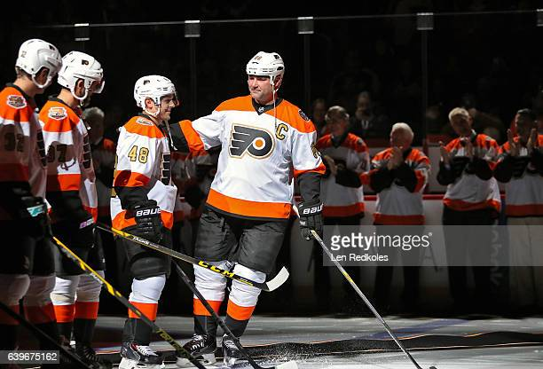 Eric Lindros of the Philadelphia Flyers Alumni skates toward teammate Danny Briere during the pregame introductions prior to playing the Pittsburgh...