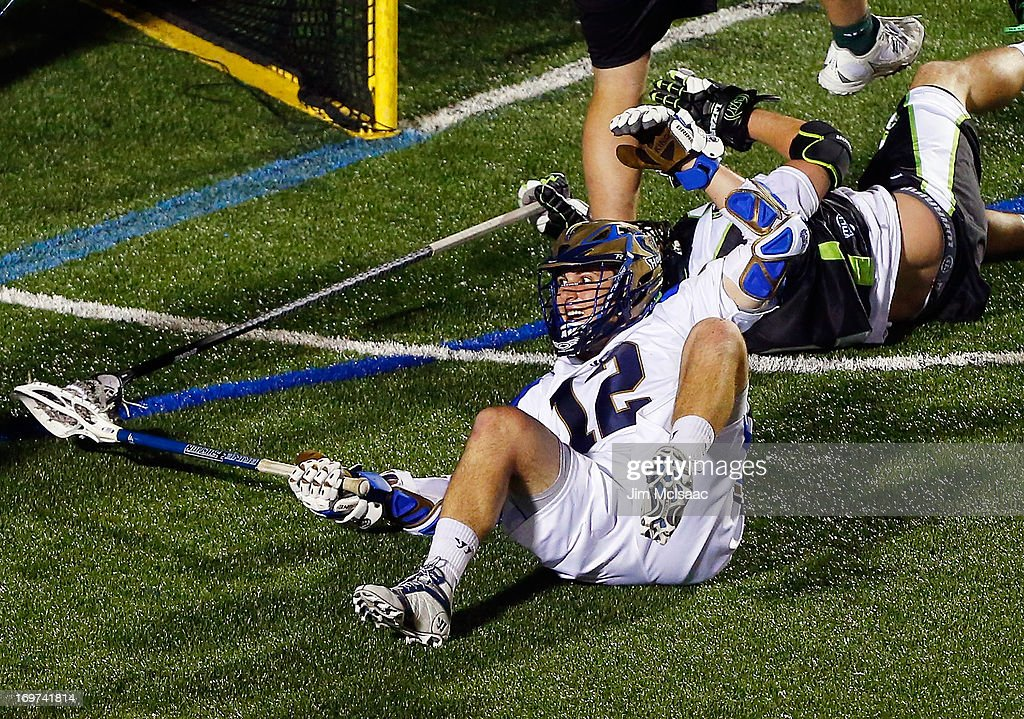 Eric Lusby #12 of the Charlotte Hounds celebrates his game-winning goal in the fourth quarter against the New York Lizardsduring their Major League Lacrosse game at Shuart Stadium on May 31, 2013 in Uniondale, New York.