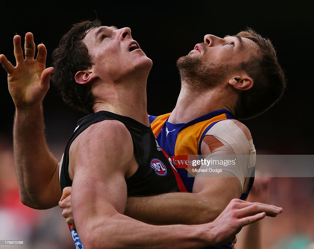 Eric Mackenzie of the Eagles contests for the ball against Jake Carlisle (L) of the Bombers during the round 20 AFL match between the Essendon Bombers and the West Coast Eagles at Etihad Stadium on August 11, 2013 in Melbourne, Australia.