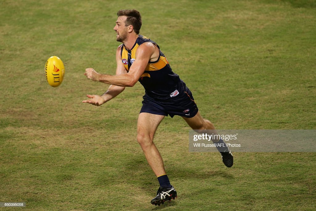 Eric Mackenzie of the Eagles handballs during the JLT Community Series AFL match between the West Coast Eagles and the Melbourne Demons at Domain Stadium on March 9, 2017 in Perth, Australia.