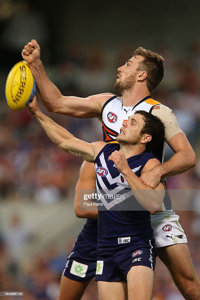 Eric Mackenzie of the Eagles spoils the mark for Hayden Ballantyne of the Dockers during the round one AFL match between the Fremantle Dockers and the West Coast Eagles at Patersons Stadium on March 23, 2013 in Perth, Australia.