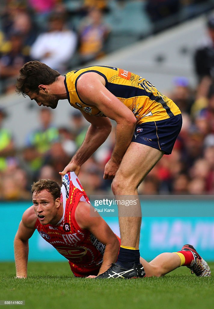Eric Mackenzie of the Eagles stands over Brandon Matera of the Suns during the round 10 AFL match between the West Coast Eagles and the Gold Coast Suns at Domain Stadium on May 29, 2016 in Perth, Australia.