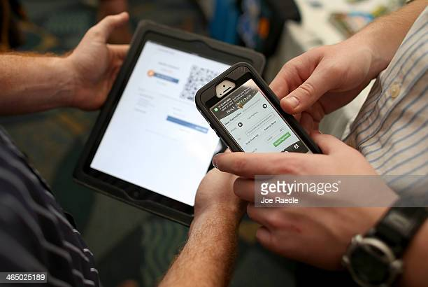 Eric Martindale and John Dreyzehner from BitPay the world leader in Bitcoin business solutions demonstrate a transaction using an ipad to charge a...