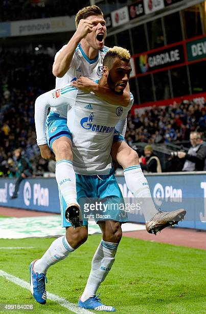Eric Maxim Choupo Moting of Schalke celebrates scoring his teams first goal with team mate Klaas Jan Huntelaar of Schalke during the Bundesliga match...