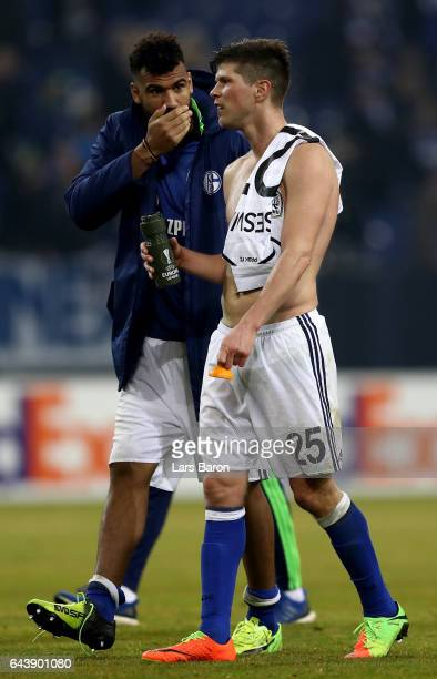 Eric Maxim Choupo Moting of Schalke speaks with team mate Klaas Jan Huntelaar after the UEFA Europa League Round of 32 second leg match between FC...