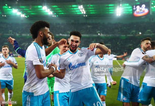 Eric Maxim ChoupoMoting of FC Schalke celebrates with Nabil Bentaleb after the UEFA Europa League Round of 16 second leg match between Borussia...