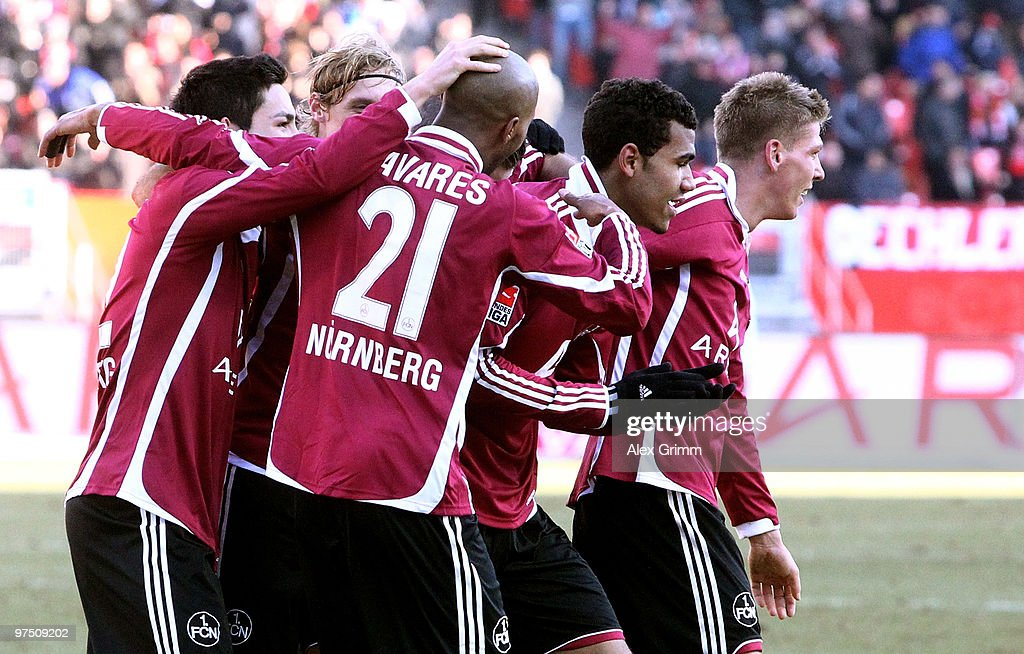 Eric Maxim ChoupoMoting of Nuernberg celebrates his team's second goal with team mates during the Bundesliga match between 1 FC Nuernberg and Bayer...