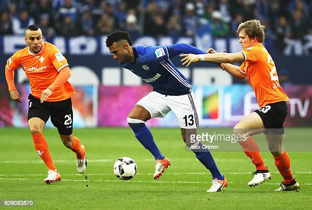 Eric Maxim ChoupoMoting of Schalke 04 is held back by Florian Jungwirth of SV Darmstadt 98 during the Bundesliga match between FC Schalke 04 and SV...