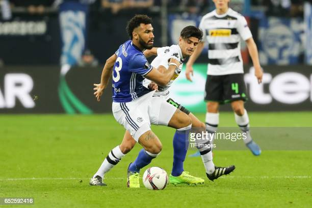 Eric Maxim ChoupoMoting of Schalke and Mahmoud Dahoud of Borussia Moenchengladbach battle for the ball during the UEFA Europa League Round of 16...