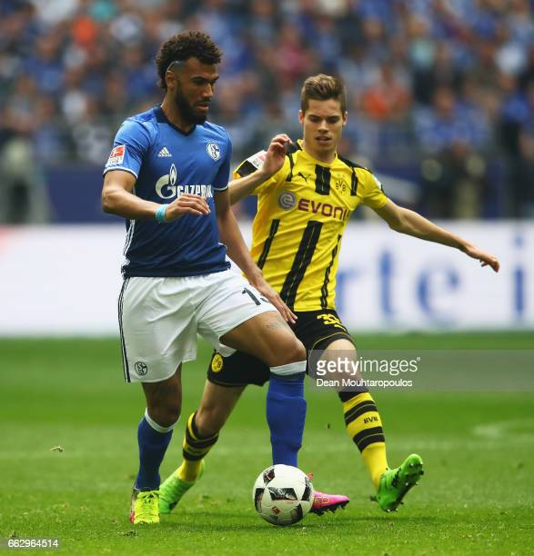 Eric Maxim ChoupoMoting of Schalke battles for the ball with Dzenis Burnic of Borussia Dortmund during the Bundesliga match between FC Schalke 04 and...