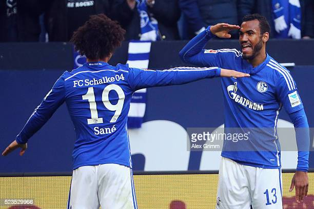 Eric Maxim ChoupoMoting of Schalke celebrates his team's first goal with team mate Leroy Sane during the Bundesliga match between FC Schalke 04 and...