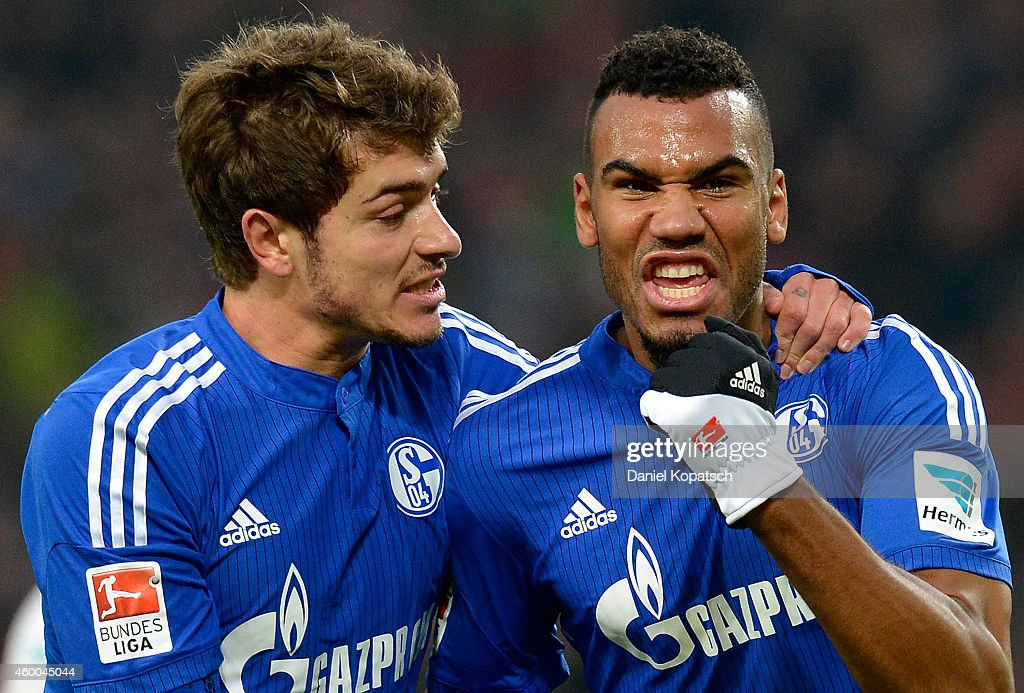 Eric Maxim ChoupoMoting of Schalke celebrates his team's third goal with team mate Roman Neustaedter during the first Bundesliga match between VfB...