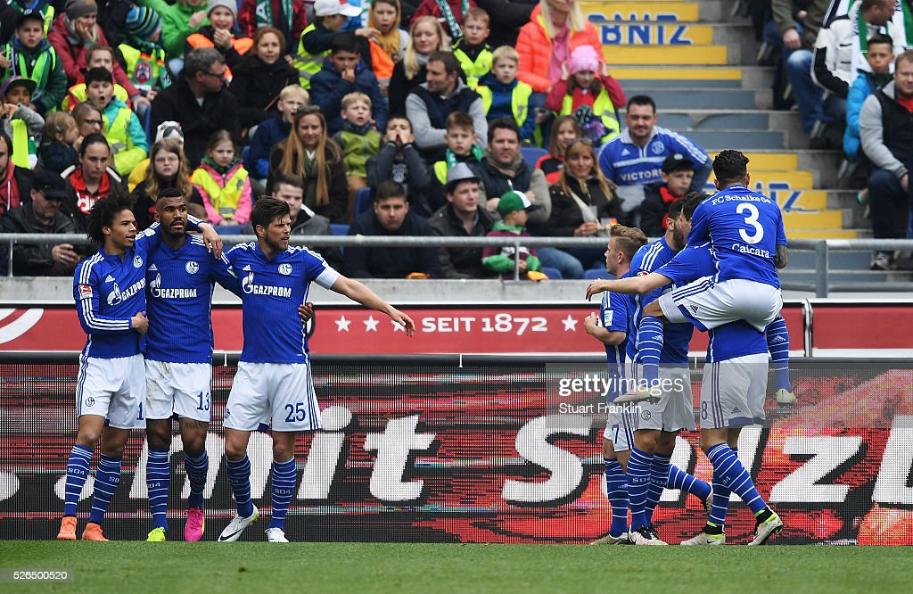 Eric Maxim Choupo-Moting of Schalke celebrates scoring his goal with teamates during the Bundesliga match between Hannover 96 and FC Schalke 04 at the HDI Arena on April 30, 2016 in Hanover, Lower Saxony.
