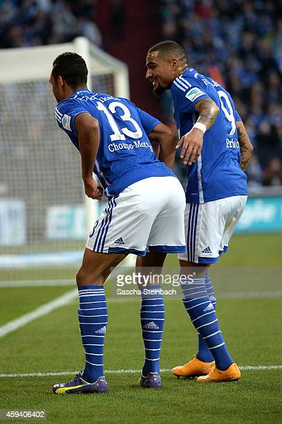 Eric Maxim ChoupoMoting of Schalke celebrates with team mate KevinPrince Boateng after scoring the opening goal during the Bundesliga match between...