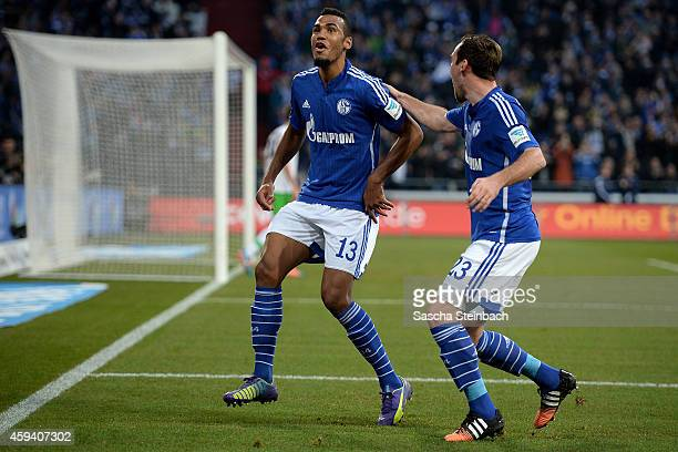 Eric Maxim ChoupoMoting of Schalke celebrates with team mate Christian Fuchs after scoring his team's second goal during the Bundesliga match between...