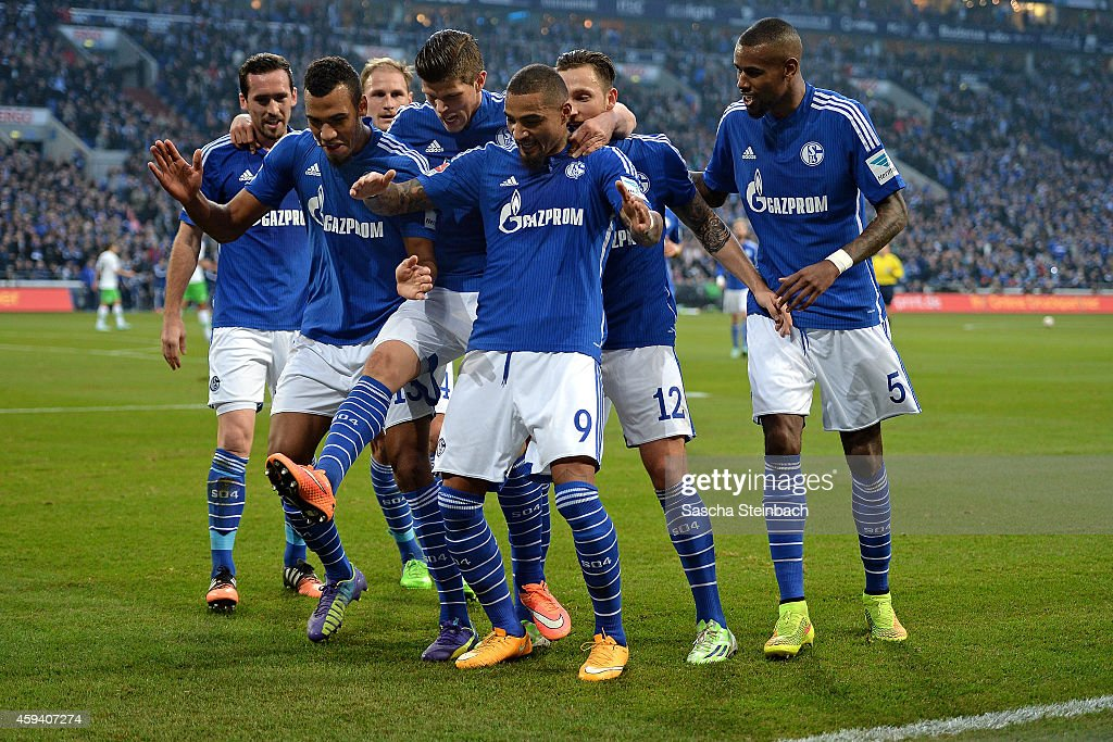 Eric Maxim Choupo-Moting (2-L) of Schalke celebrates with team mates after scoring his team's second goal during the Bundesliga match between FC Schalke 04 and VfL Wolfsburg at Veltins Arena on November 22, 2014 in Gelsenkirchen, Germany.