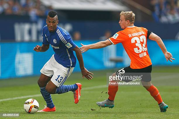 Eric Maxim ChoupoMoting of Schalke gets past the trackle from Fabian Holland of Darmstadt during the Bundesliga match between FC Schalke 04 and SV...