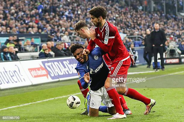Eric Maxim ChoupoMoting of Schalke Pascal Gross of Ingolstadt and Romain Bregerie of Ingolstadt fight for the ball during the Bundesliga match...