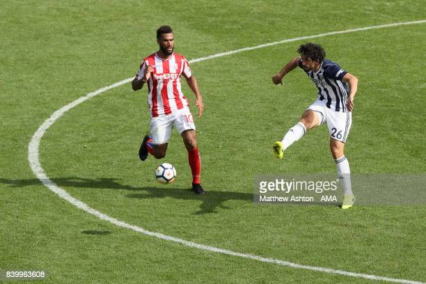 Eric Maxim ChoupoMoting of Stoke City and Ahmed Hegazy of West Bromwich Albion during the Premier League match between West Bromwich Albion and Stoke...