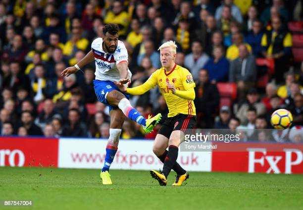 Eric Maxim ChoupoMoting of Stoke City shoots at goal past Will Hughes of Watford during the Premier League match between Watford and Stoke City at...