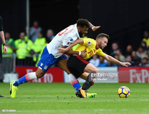 Eric Maxim ChoupoMoting of Stoke City tackles Tom Cleverley of Watford during the Premier League match between Watford and Stoke City at Vicarage...