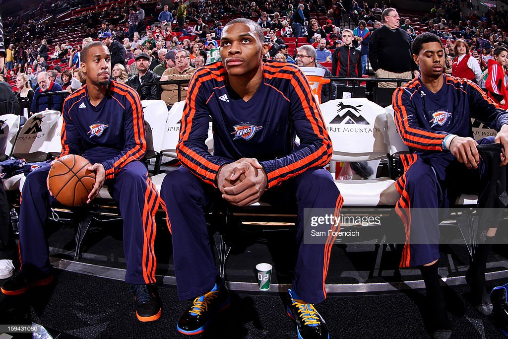 Eric Maynor #6, left, and Russell Westbrook #0 of the Oklahoma City Thunder sit on the bench before playing the Portland Trail Blazers on January 13, 2013 at the Rose Garden Arena in Portland, Oregon.