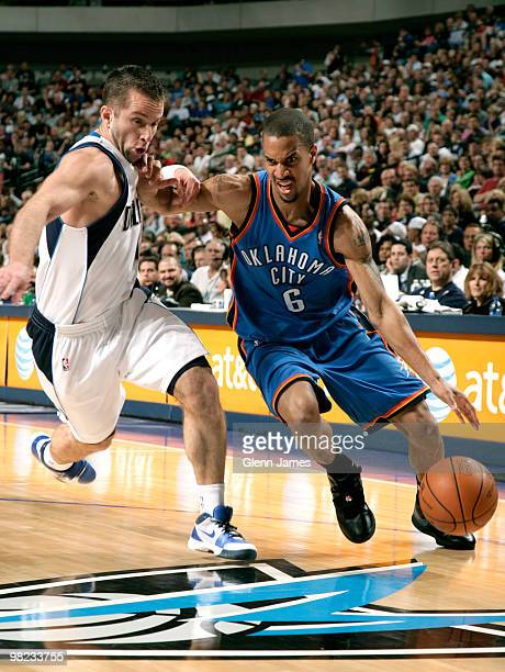 Eric Maynor of the Oklahoma City Thunder drives against Jose Juan Barea of the Dallas Mavericks during a game at the American Airlines Center on...