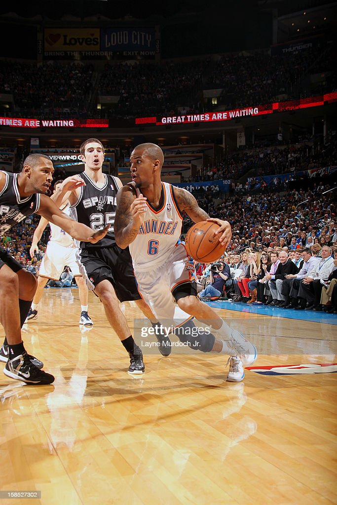 <a gi-track='captionPersonalityLinkClicked' href=/galleries/search?phrase=Eric+Maynor&family=editorial&specificpeople=4194194 ng-click='$event.stopPropagation()'>Eric Maynor</a> #6 of the Oklahoma City Thunder drives to the basket against the San Antonio Spurs during an NBA game on December 17, 2012 at the Chesapeake Energy Arena in Oklahoma City, Oklahoma.