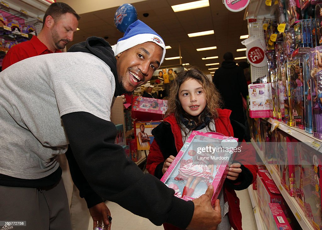 <a gi-track='captionPersonalityLinkClicked' href=/galleries/search?phrase=Eric+Maynor&family=editorial&specificpeople=4194194 ng-click='$event.stopPropagation()'>Eric Maynor</a> of the Oklahoma City Thunder shops for toys during a holiday shopping spree with ten families from the Grandparents Raising Grandchildren program on Tuesday, Dec. 13 at a Target store in northwest Oklahoma City in Oklahoma City, Oklahoma.