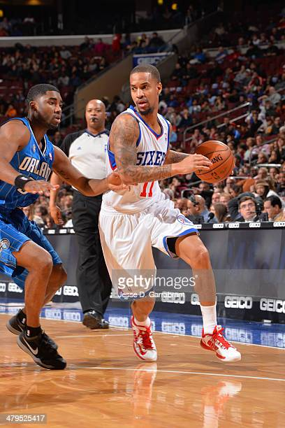 Eric Maynor of the Philadelphia 76ers dribbles the ball against the Orlando Magic at the Wells Fargo Center on February 26 2014 in Philadelphia...