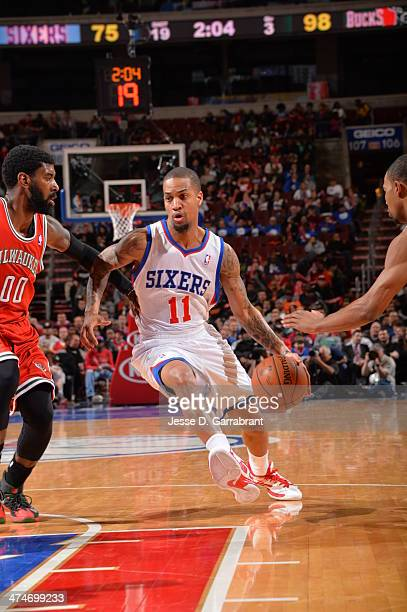 Eric Maynor of the Philadelphia 76ers drives to the basket against the Milwaukee Bucks at the Wells Fargo Center on February 24 2014 in Philadelphia...