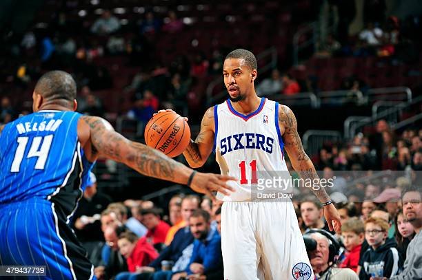 Eric Maynor of the Philadelphia 76ers handles the ball against the Orlando Magic on February 26 2014 at the Wells Fargo Center in Philadelphia...