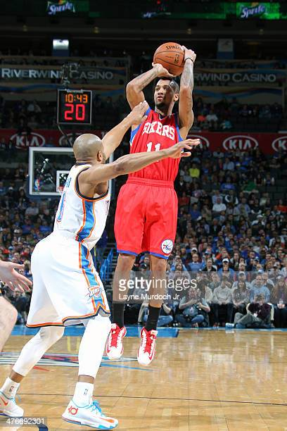 Eric Maynor of the Philadelphia 76ers shoots the ball against the Oklahoma City Thunder during an NBA game on March 4 2014 at the Chesapeake Energy...