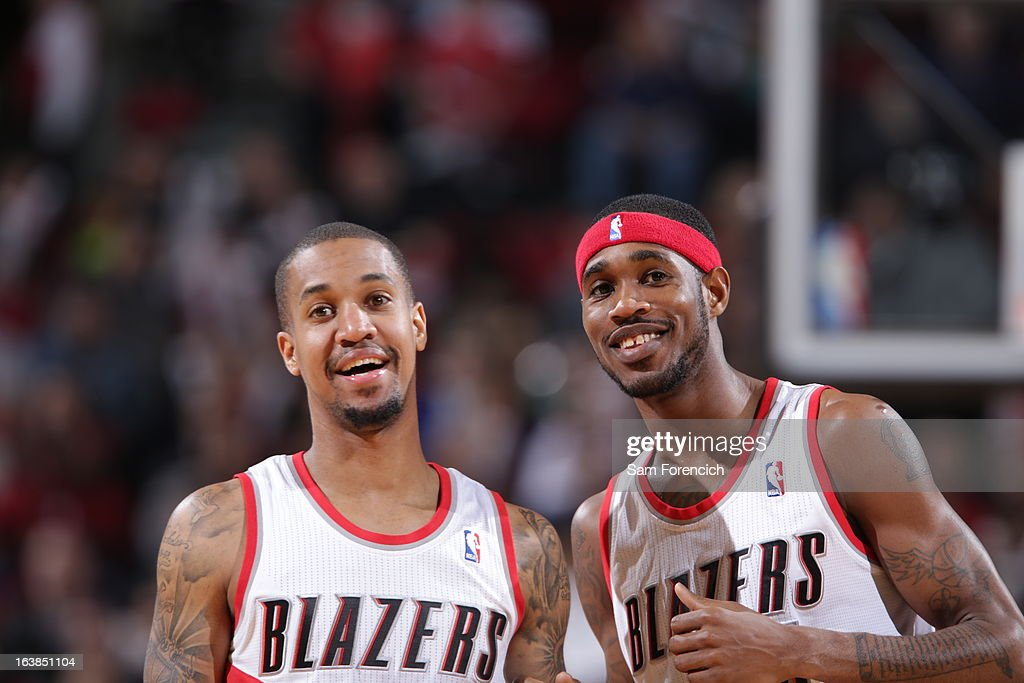 Eric Maynor #6 of the Portland Trail Blazers and Will Barton #5 of the Portland Trail Blazers celebrate look on during the game between the Detroit Pistons and the Portland Trail Blazers on March 16, 2013 at the Rose Garden Arena in Portland, Oregon.
