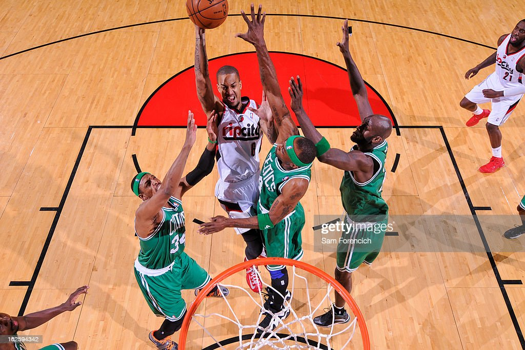 Eric Maynor #6 of the Portland Trail Blazers attempts a shot in the lane in his debut game for the team against Paul Pierce #34, Jason Terry #4 and Kevin Garnett #5 of the Boston Celtics on February 24, 2013 at the Rose Garden Arena in Portland, Oregon.