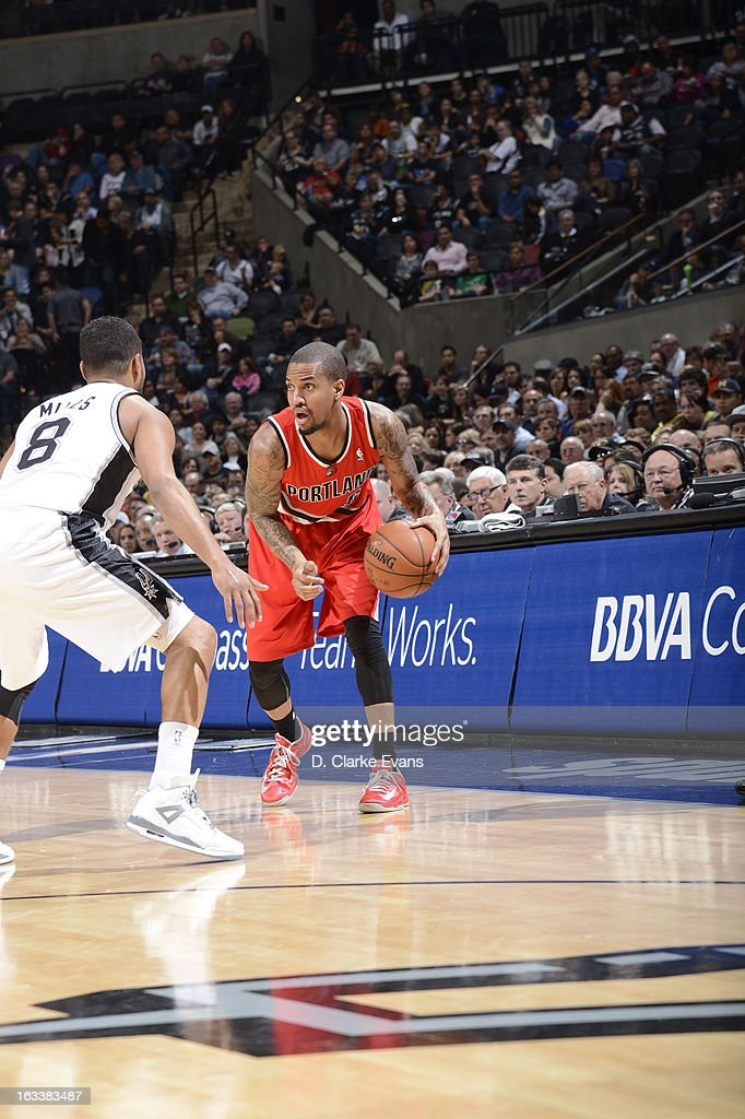 <a gi-track='captionPersonalityLinkClicked' href=/galleries/search?phrase=Eric+Maynor&family=editorial&specificpeople=4194194 ng-click='$event.stopPropagation()'>Eric Maynor</a> #6 of the Portland Trail Blazers dribbles the ball against the San Antonio Spurs on MARCH 8, 2013 at the AT&T Center in San Antonio, Texas.