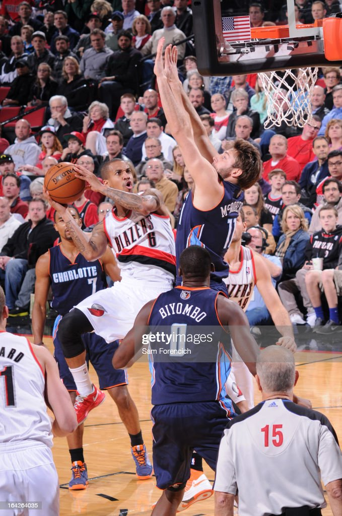 <a gi-track='captionPersonalityLinkClicked' href=/galleries/search?phrase=Eric+Maynor&family=editorial&specificpeople=4194194 ng-click='$event.stopPropagation()'>Eric Maynor</a> #6 of the Portland Trail Blazers goes to the basket against <a gi-track='captionPersonalityLinkClicked' href=/galleries/search?phrase=Josh+McRoberts&family=editorial&specificpeople=732530 ng-click='$event.stopPropagation()'>Josh McRoberts</a> #11 of the Charlotte Bobcats on March 4, 2013 at the Rose Garden Arena in Portland, Oregon.