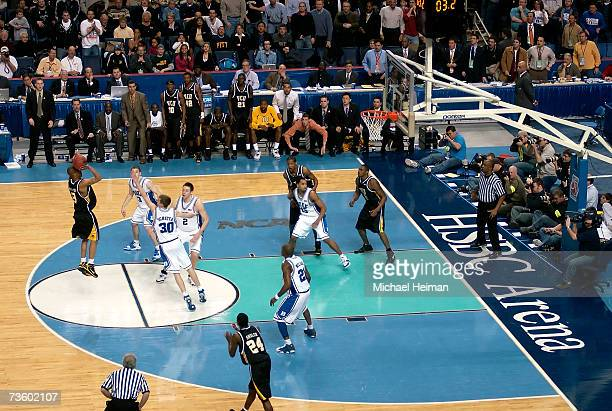 Eric Maynor of the Virginia Commonwealth Rams shoots the game winning shot over Jon Scheyer of the Duke Blue Devils during round one of the NCAA...
