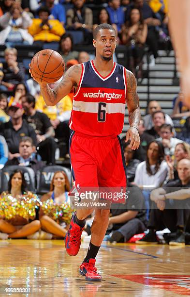 Eric Maynor of the Washington Wizards advances the ball against the Golden State Warriors on January 28 2014 at Oracle Arena in Oakland California...