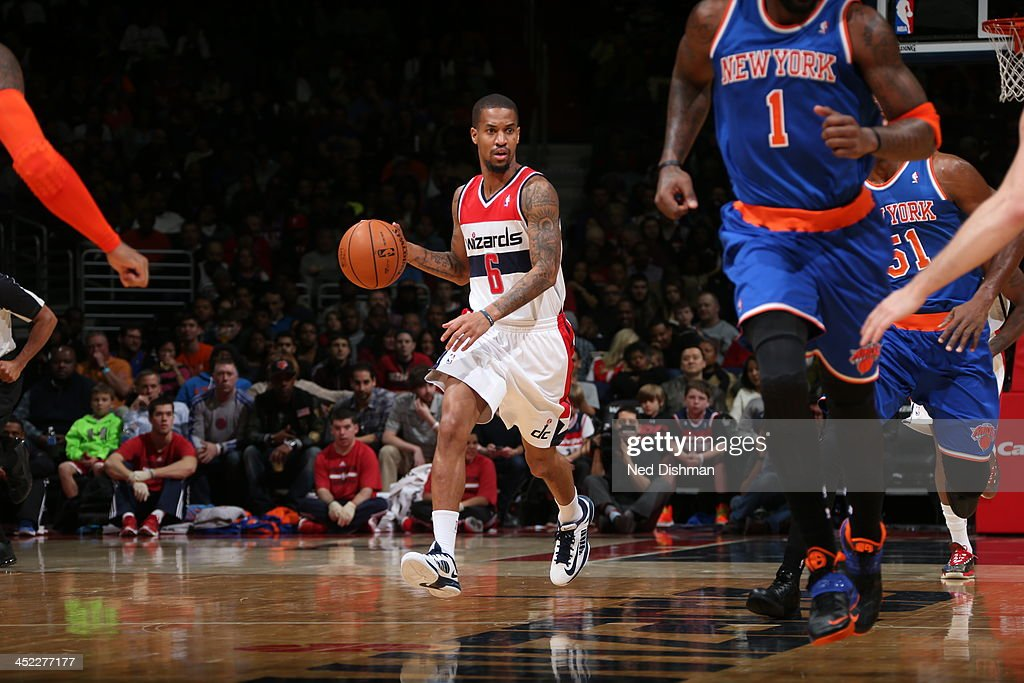 <a gi-track='captionPersonalityLinkClicked' href=/galleries/search?phrase=Eric+Maynor&family=editorial&specificpeople=4194194 ng-click='$event.stopPropagation()'>Eric Maynor</a> #6 of the Washington Wizards dribbles up the court against the New York Knicks during the game at the Verizon Center on November 23, 2013 in Washington, DC.